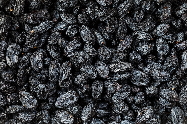 Schwarze rosinenbeschaffenheit, populäre trockenfrüchte. getrocknete trauben.