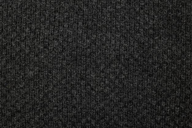 Schwarze stoffbeschaffenheit, stoffmusterhintergrund.