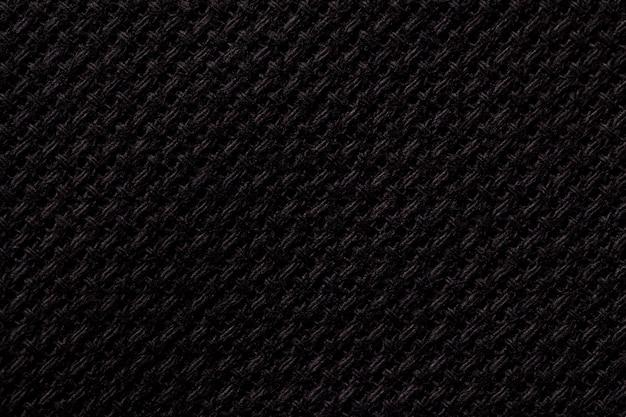 Schwarze textilnahaufnahme, struktur des gewebemakros