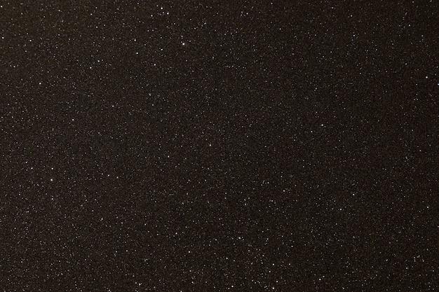 Schwarze textur mit mikrorelief und glitzer. schwarze glitzer-textur