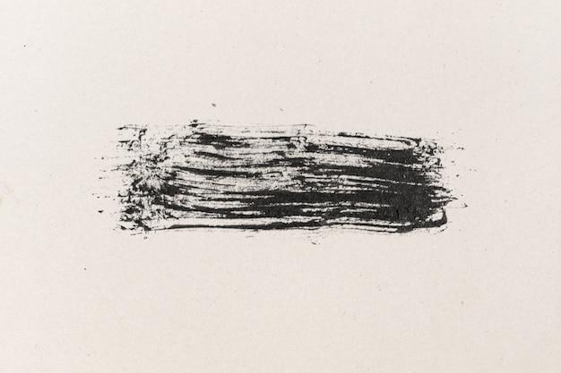 Schwarze tintenform auf strukturiertem hintergrund des aquarellpapiers Premium Fotos