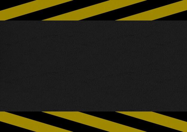Schwarze und gelbe vorsichtlinie auf zementstraßenhintergrund.