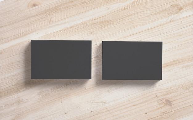 Schwarze visitenkartenstapel auf hölzernem hintergrund. vorlage zur präsentation ihrer präsentation.