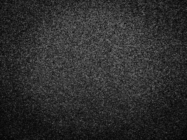 Schwarzer asphaltboden oder straßenbeschaffenheitshintergrund.