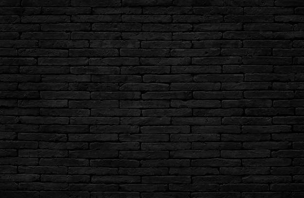Schwarzer backsteinmauerbeschaffenheitshintergrund mit altem schmutzigem und weinleseartmuster