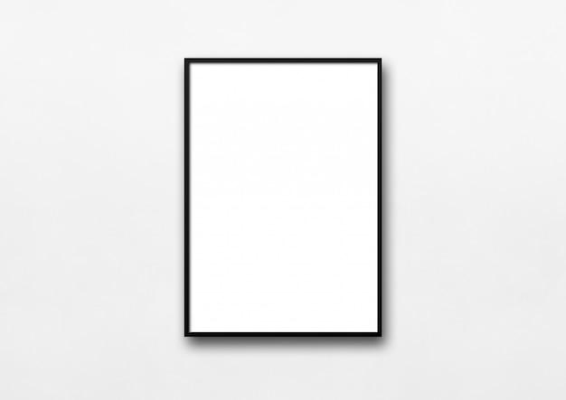 Schwarzer bilderrahmen, der an einer weißen wand hängt
