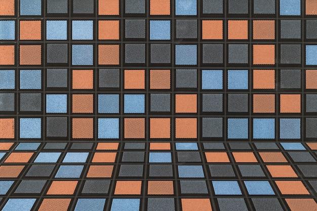 Schwarzer blauer grauer und orange abstrakter hintergrund und beschaffenheit der mosaik-fliesen