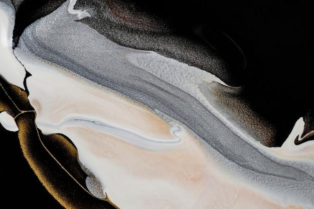 Schwarzer flüssiger marmorhintergrund handgemachte acrylfarbe