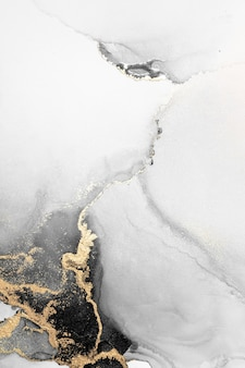 Schwarzer goldzusammenfassungshintergrund der kunstmalerei der flüssigen marmortinte auf papier.