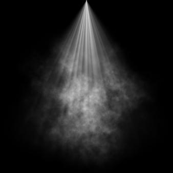 Schwarzer hintergrund mit rauche im scheinwerferlicht