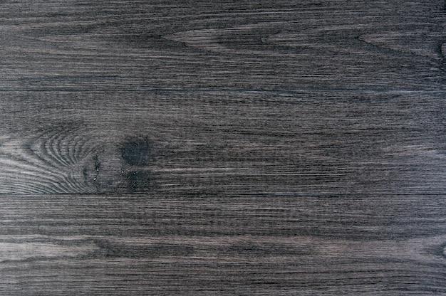 Schwarzer hölzerner, alter dunkelgrauer hintergrund, weinlesebeschaffenheit