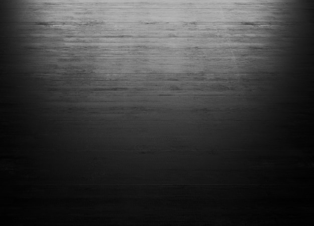 Schwarzer hölzerner hintergrund mit beleuchtung vom fenster