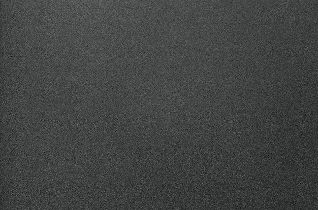 Schwarzer körniger plastikhintergrund
