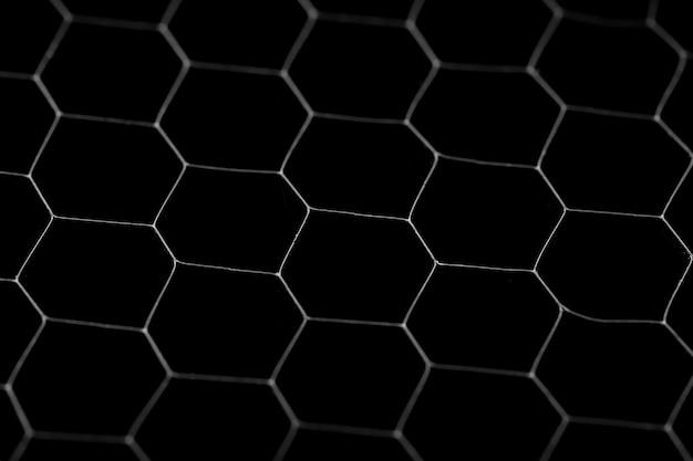 Schwarzer kreis hintergrund. stahlgitter, schwarzes gitter der beschaffenheit.