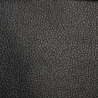 Schwarzer kunstleder-textur-hintergrund