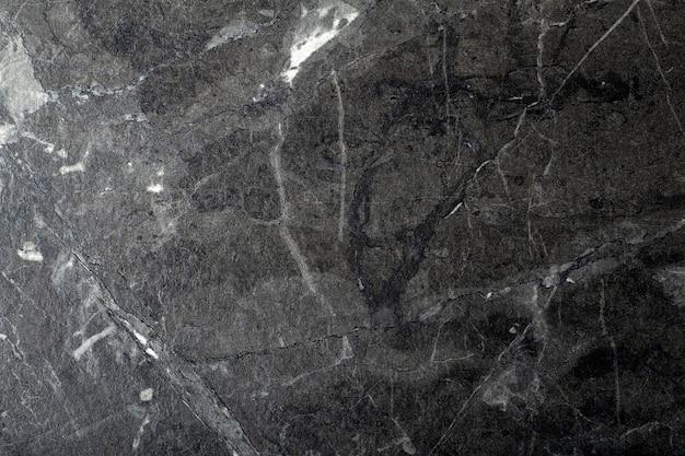 Schwarzer marmorhintergrund.