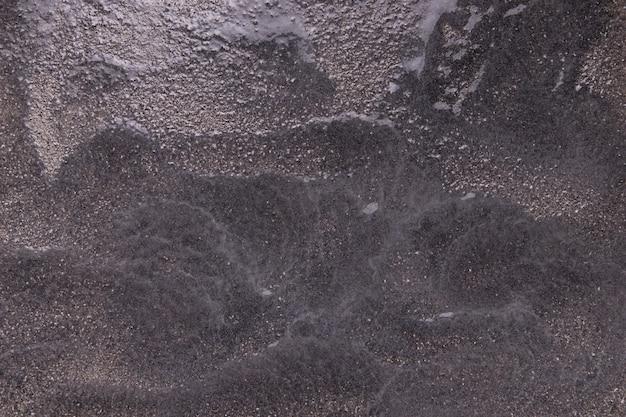 Schwarzer papierbeschaffenheitshintergrund