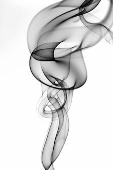 Schwarzer rauch auf weißem hintergrund.
