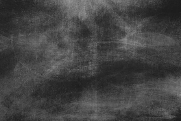 Schwarzer rustikaler leerer tafelhintergrund