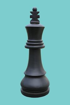 Schwarzer schachkönig, der lokal auf cyanem hintergrund steht