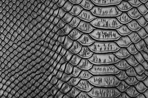 Schwarzer schlangenhautmuster-beschaffenheitshintergrund