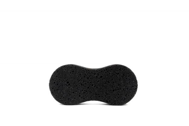 Schwarzer schwamm für nah oben säubern und waschen, lokalisiert auf weißer szene.