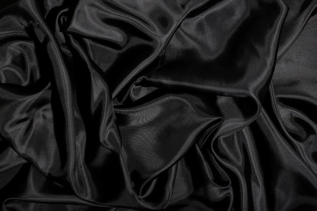 Schwarzer seidenstoffbeschaffenheitshintergrund