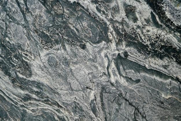 Schwarzer steinmusterhintergrund u. tapete
