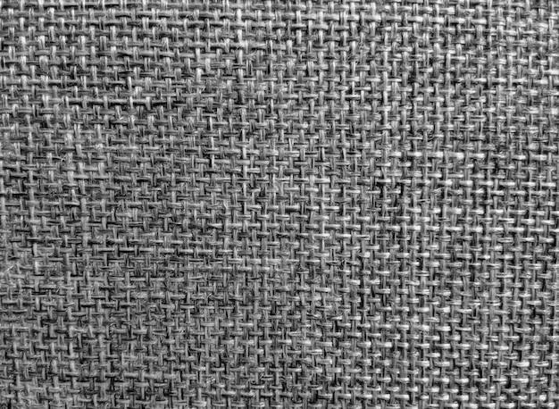 Schwarzer stoff abstrakter dunkler und grauer texturhintergrund.