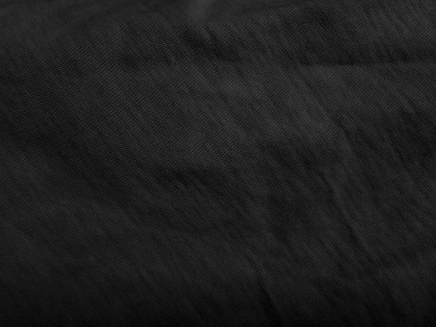 Schwarzer stoff abstrakter texturhintergrund.