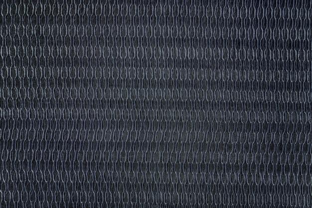 Schwarzer stoff mit strukturiertem hintergrund