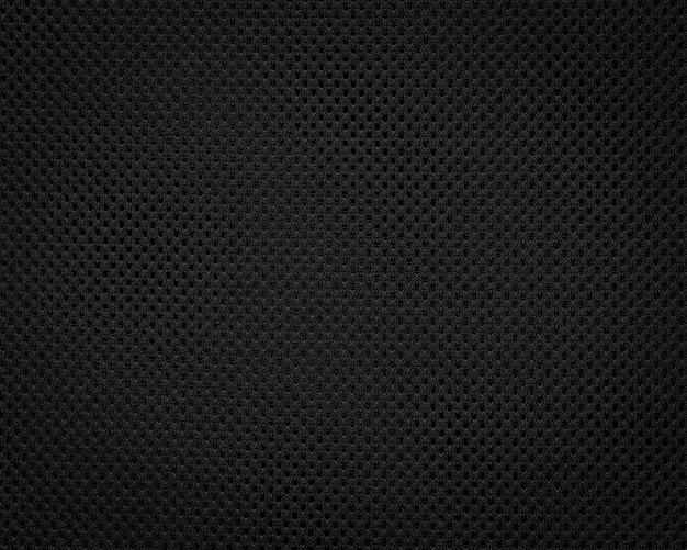 Schwarzer stoff textur. dunkler textilmusterhintergrund. detail aus synthetischem material.