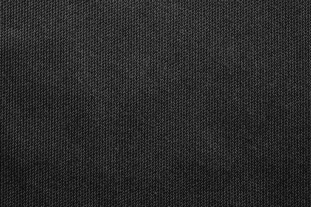 Schwarzer stoff texturmuster hintergrund