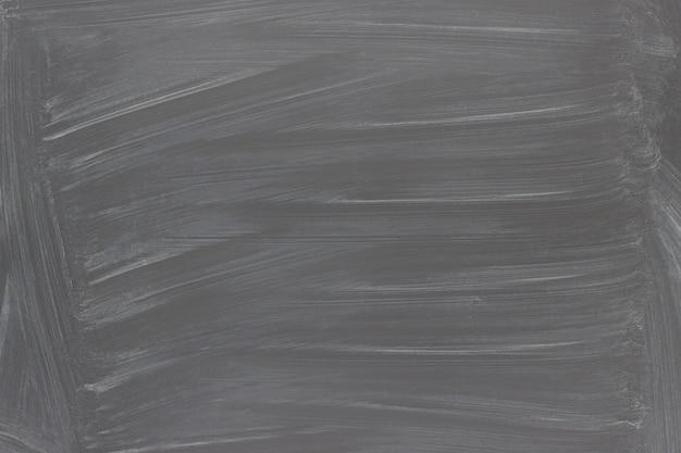 Schwarzer tafelhintergrund. textur tafel mit kreidespuren