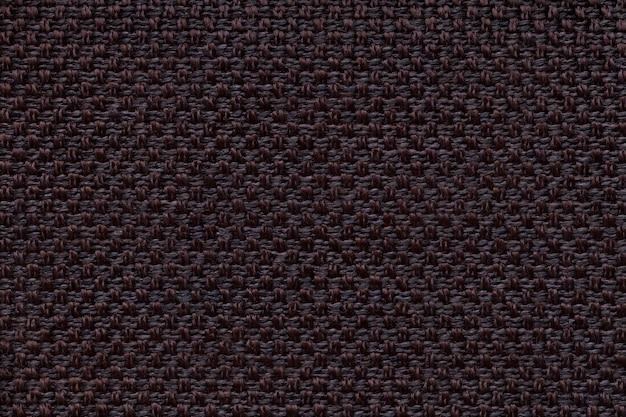 Schwarzer textilhintergrund mit kariertem design, nahaufnahme. struktur des gewebemakros.