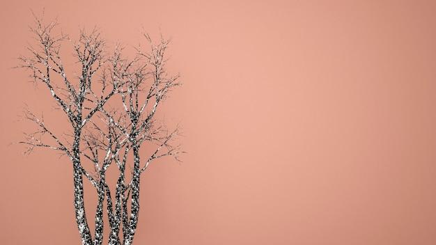 Schwarzer trockener baum auf altem rosafarbenem farbhintergrund