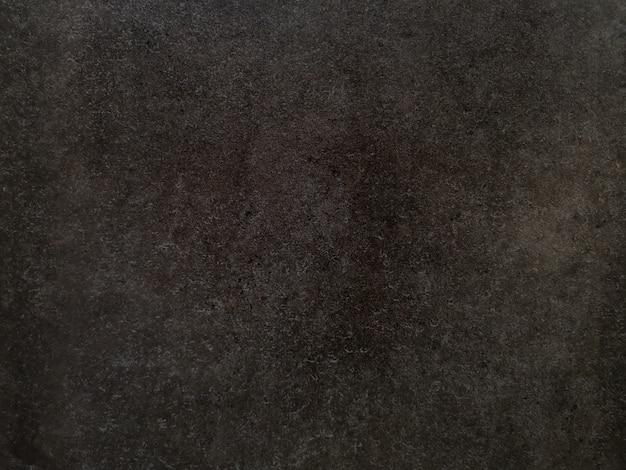 Schwarzer und brauner strukturierter hintergrund