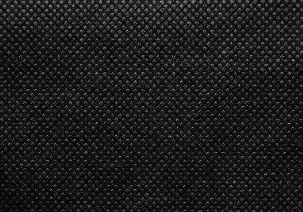 Schwarzer vlies- oder spinnvlies-texturhintergrund