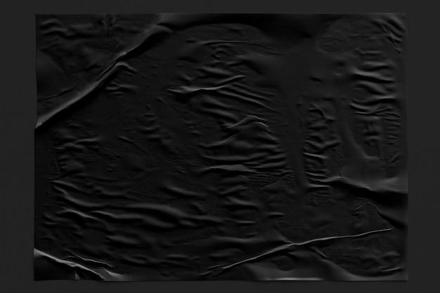 Schwarzer zerknitterter papierbeschaffenheitshintergrund