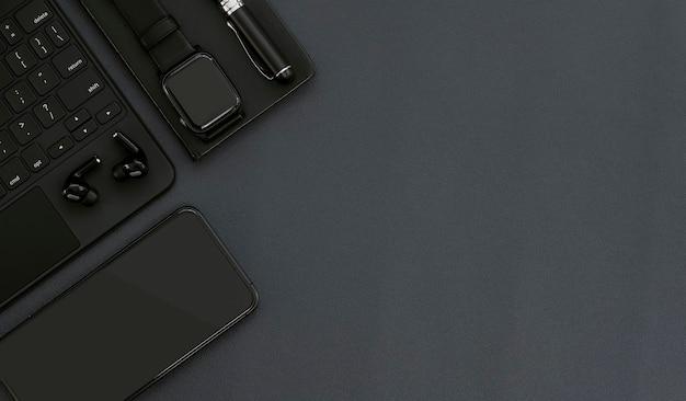 Schwarzes design des arbeitsbereichs der draufsicht mit computertastatur, smartwatch, smartphone, kopfhörer, stift und buch, kopierraum.