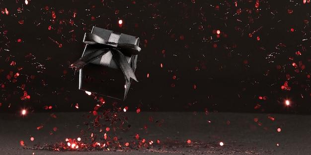 Schwarzes freitagsgeschenk mit rotem glitzer