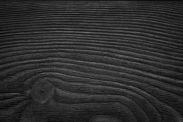 Schwarzes holzbrett, tischplatte, bodenfläche oder hacken, dunkle holzstruktur