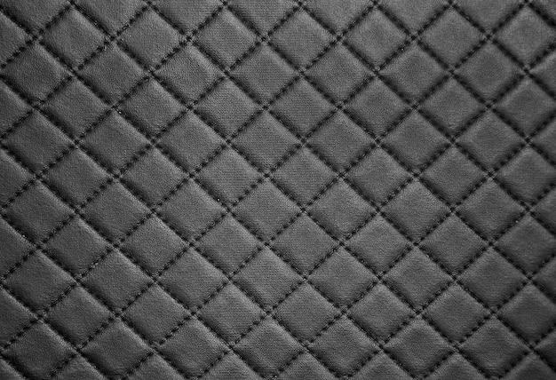 Schwarzes leder textur mit naht hintergrund