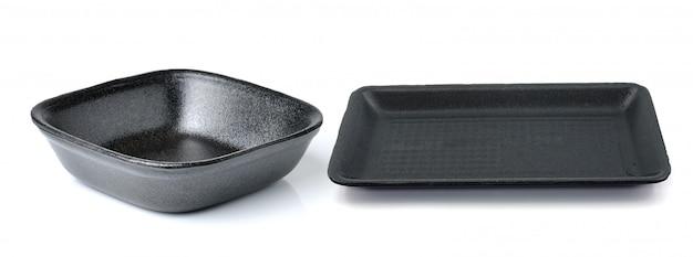 Schwarzes leeres essenstablett. auf weißem raum isoliert