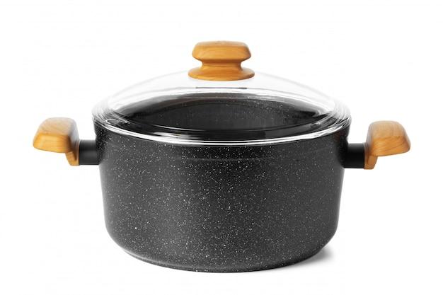 Schwarzes neues kochgeschirr-utensil lokalisiert auf weiß