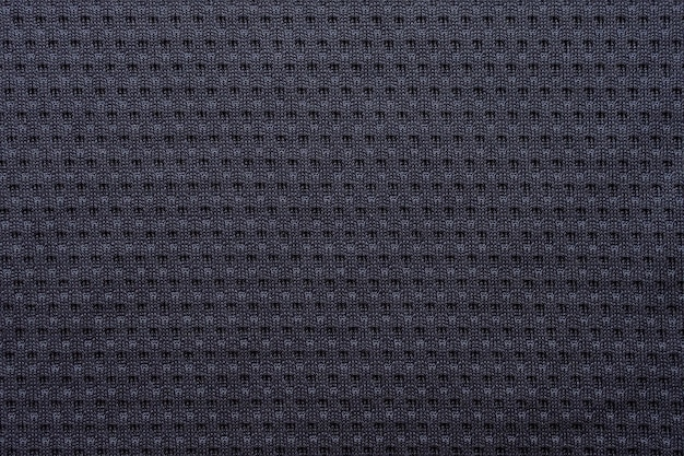 Schwarzes stoff-sportbekleidungs-fußballtrikot mit air-mesh-texturhintergrund