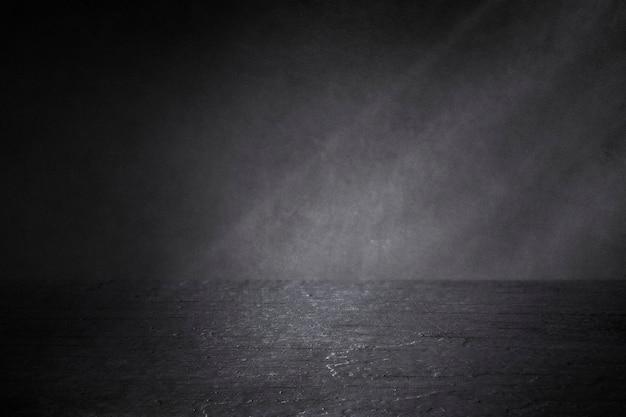 Schwarzes strukturiertes hintergrunddesign aus holz