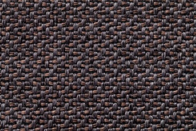 Schwarzes und braunes weinlesegewebe mit gesponnener beschaffenheitsnahaufnahme. textilmakrohintergrund