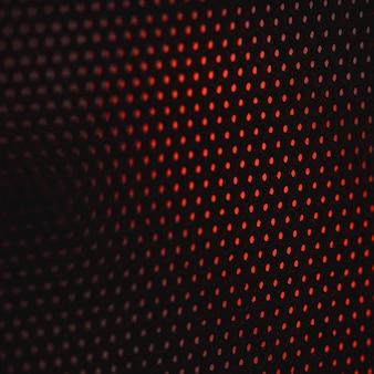Schwarzes und rotes gepunktetes textil