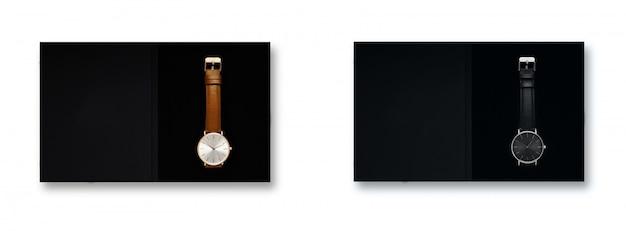 Schwarzes zifferblatt der klassischen frauengolduhr, lederband, isolat auf weißem hintergrund